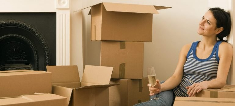 Woman drinking champagne in new home