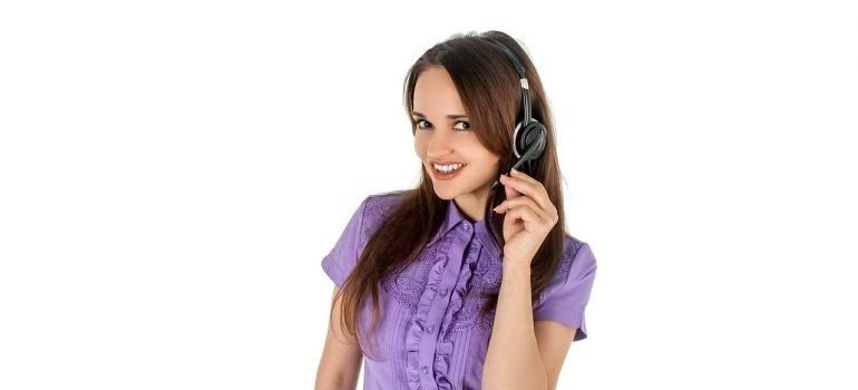 A girl wearing a headset, representing household movers