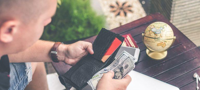 man-holding-u-s-dollar-banknotes