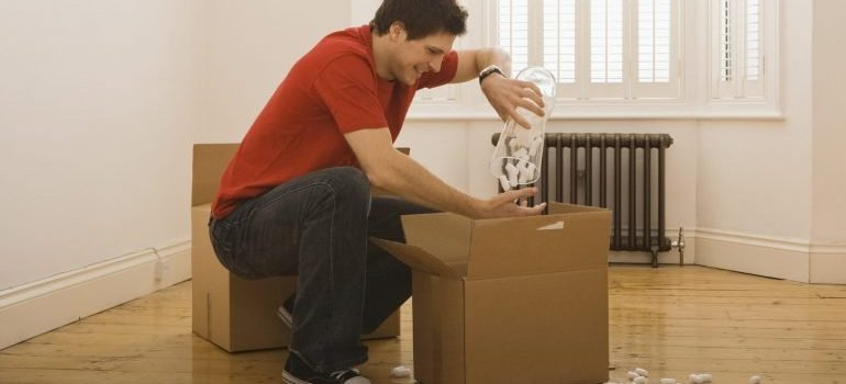Man unpacking boxes in new home - Orlando long distance movers